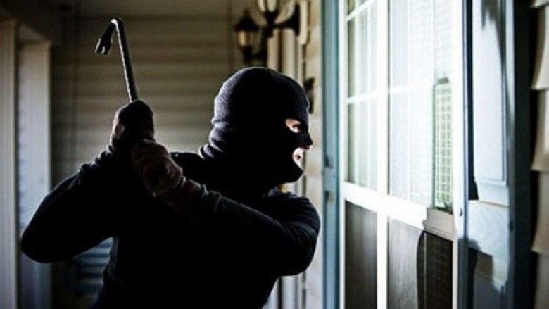 A Thief Trying To Break The Roller Shutter - Representing The Roller Shutter Security.